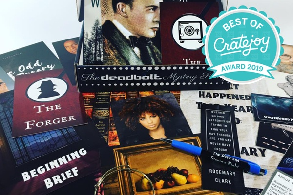 The Deadbolt Mystery Society Monthly subscription box with several cards around it titled The Forger and Beginning Brief.