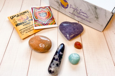 A Soul Gifts subscription box with a mineral soap, bath soak, and crystals of various colors and shapes.