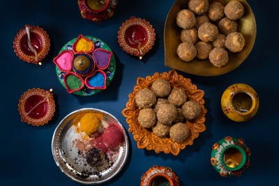 Colorful and ornate dishes are filled with exotic, artisan Indian sweets called Laddu.