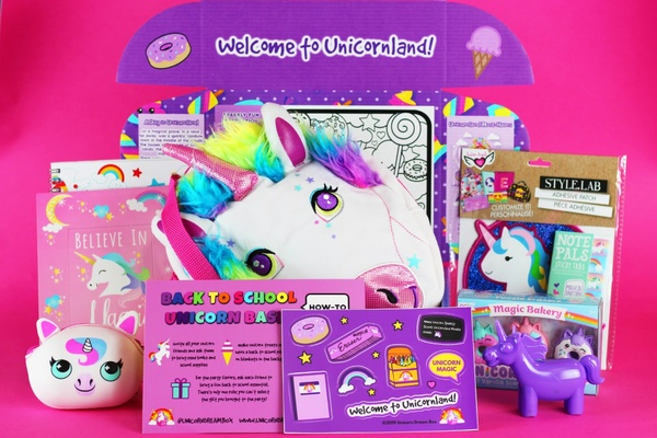 A Unicorn Dream subscription box with various unicorn toys, coloring books and stickers.