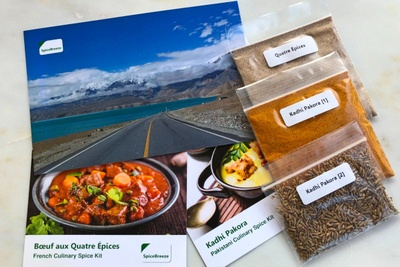 Items from a Spice Breeze subscription box including 3 packets of spices and recipe cards.