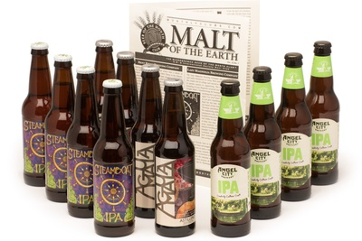 Several beer bottles of different types of IPA and a booklet called Malt of the Earth from The Hop-Heads Beer Club.