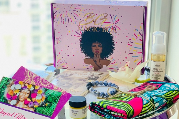 A Black Girl Magic subscription box with self-care items such as body washes, a bracelet, a colorful towel and more.