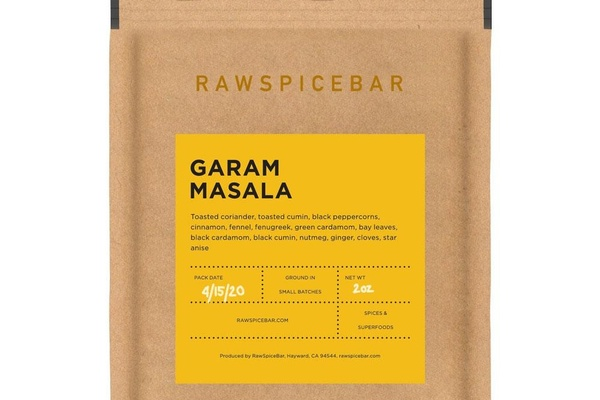 A brown packet with Raw Spice Bar at the top and a label that says Garam Masala and an ingredients list and other info.