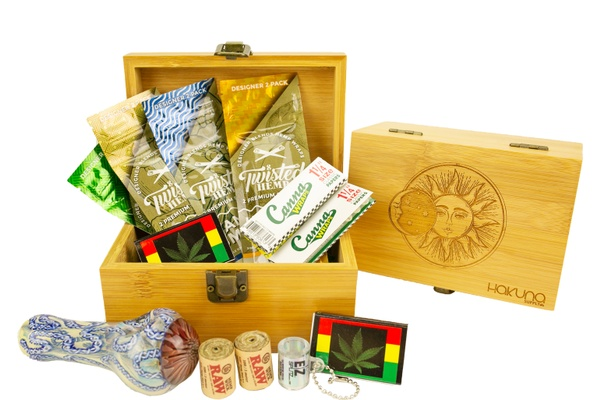 A Hakuna Supply subscription box filled with eco-friendly stone bundles including rolling papers, hemp wick rolls and more.