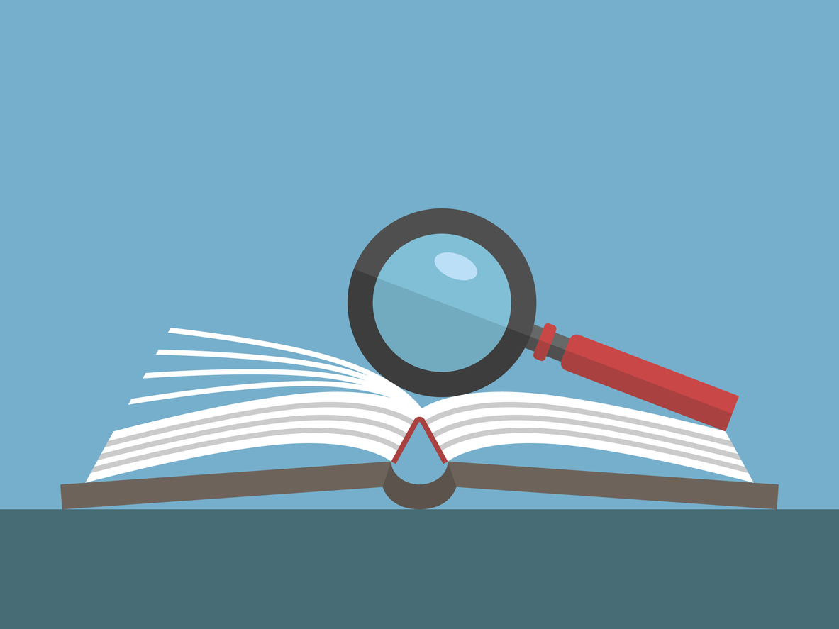 Magnifying glass on open book over blue background