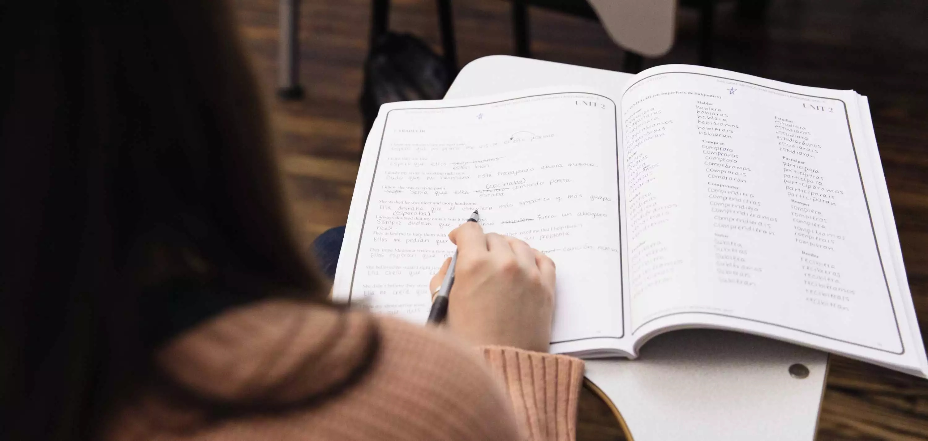 Woman studying with a textbook
