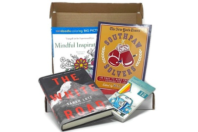 An open staycation box with 4 books.