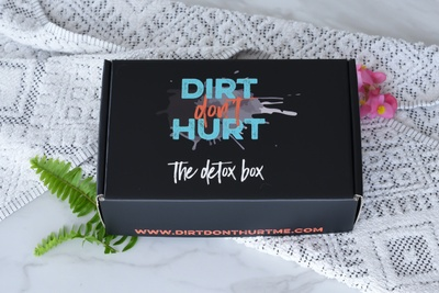 A closed The Detox Box subscription box that says dirt don't hurt.
