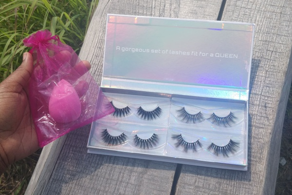 A set of false lashes and an application sponge from a Queen Lash subscription box.