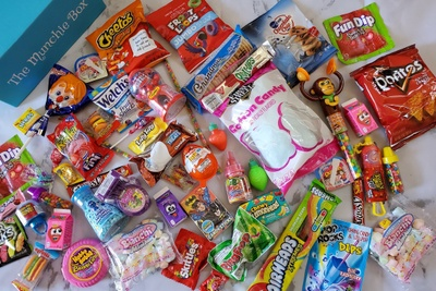 The Munchie Box subscription box with Cheetos, fruit snacks, fun dip, cotton candy, skittles and other snacks and candy.