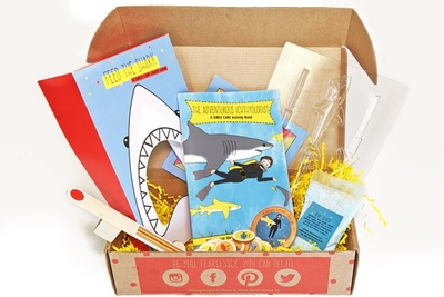 A Girls Can subscription box with activity books, hands on STEAM activities and inspiration for girl power.