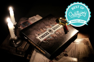 Finders Seekers Escape Room Game subscription box with burning candles around it and the Best of Cratejoy Award 2019 emblem.