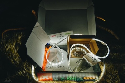 A Mountain Hunter subscription box that is open and showing light-up rope and other rugged gear for big game hunters.