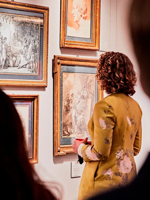 woman viewing paintings