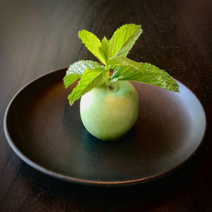 Green apple inspired by Magritte's Son of Man