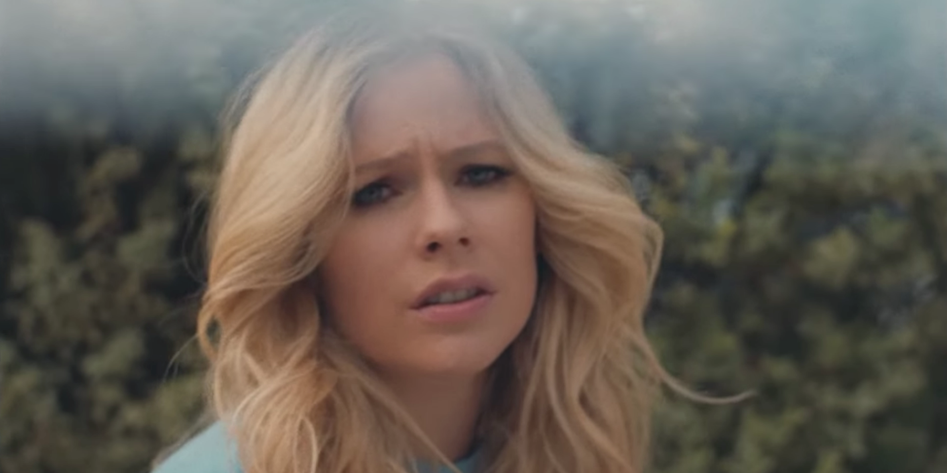 Avril Lavigne embraces her vulnerability in new music video 'Tell Me It's Over' — watch
