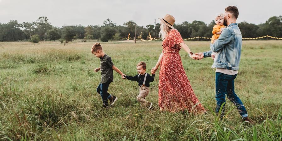 A family walking through a field