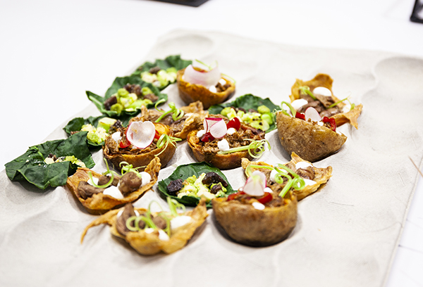 'Tacos' made from potato skins, chicken skins and broccoli leaves