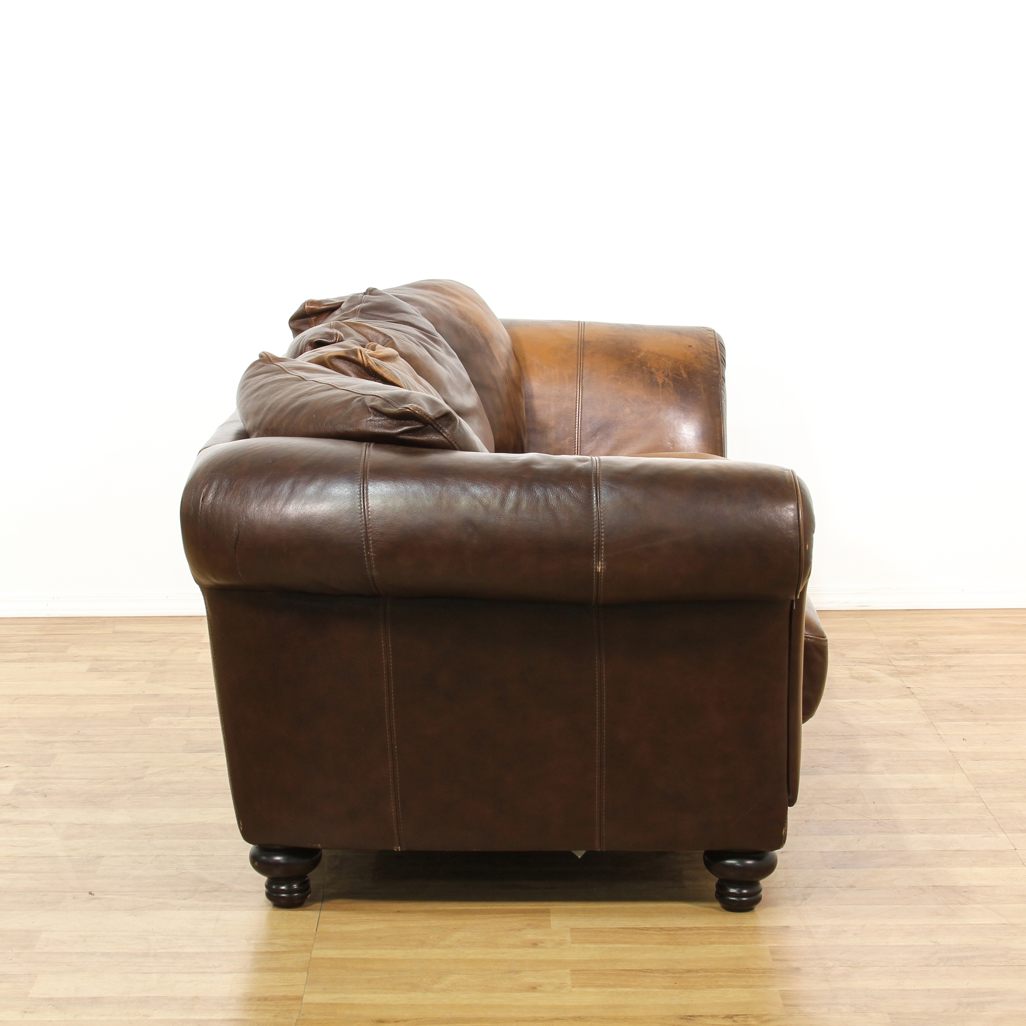 Vintage Upholstered Leather Sofa: Distressed Brown Leather Upholstered Sofa