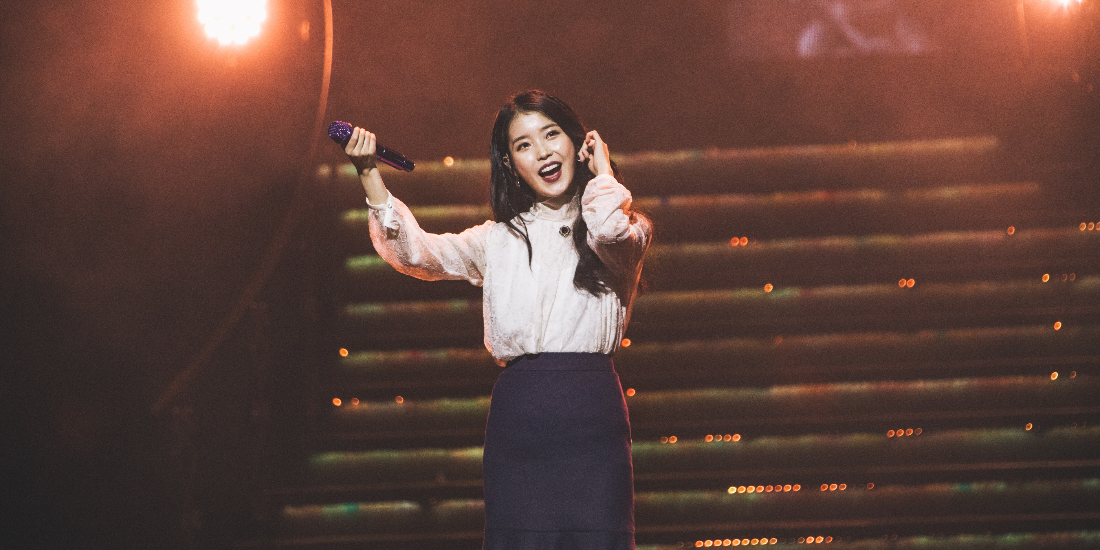 IU charms at her debut Singapore show — gig report