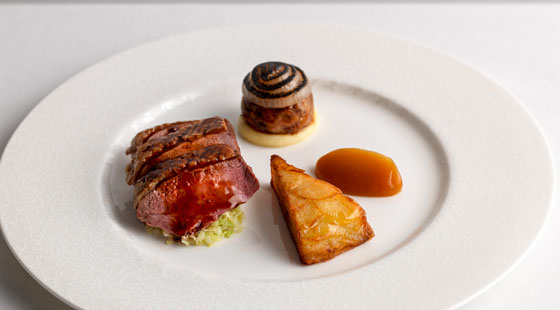 Creedy Carver duck breast and foggot with savoy cabbage, rotisserie apple sauce and duck fat pommes Anna