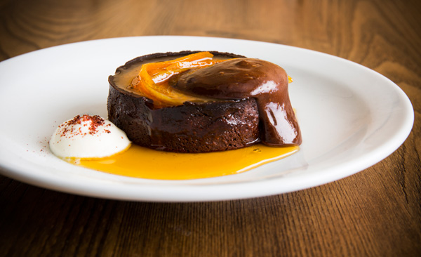 Hot chocolate tart, blood orange marmalade, crème fraÁ®che and sumac
