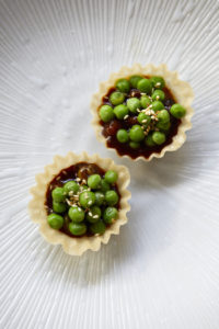 Wagyu beef with fermented black bean tart and dressed peas