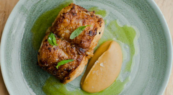 Roast monkfish with spiced aubergine, basil and ginger dressing