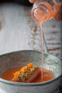 Aperol spritz-poached rhubarb, lemon balm crumble and Darwin's barberry