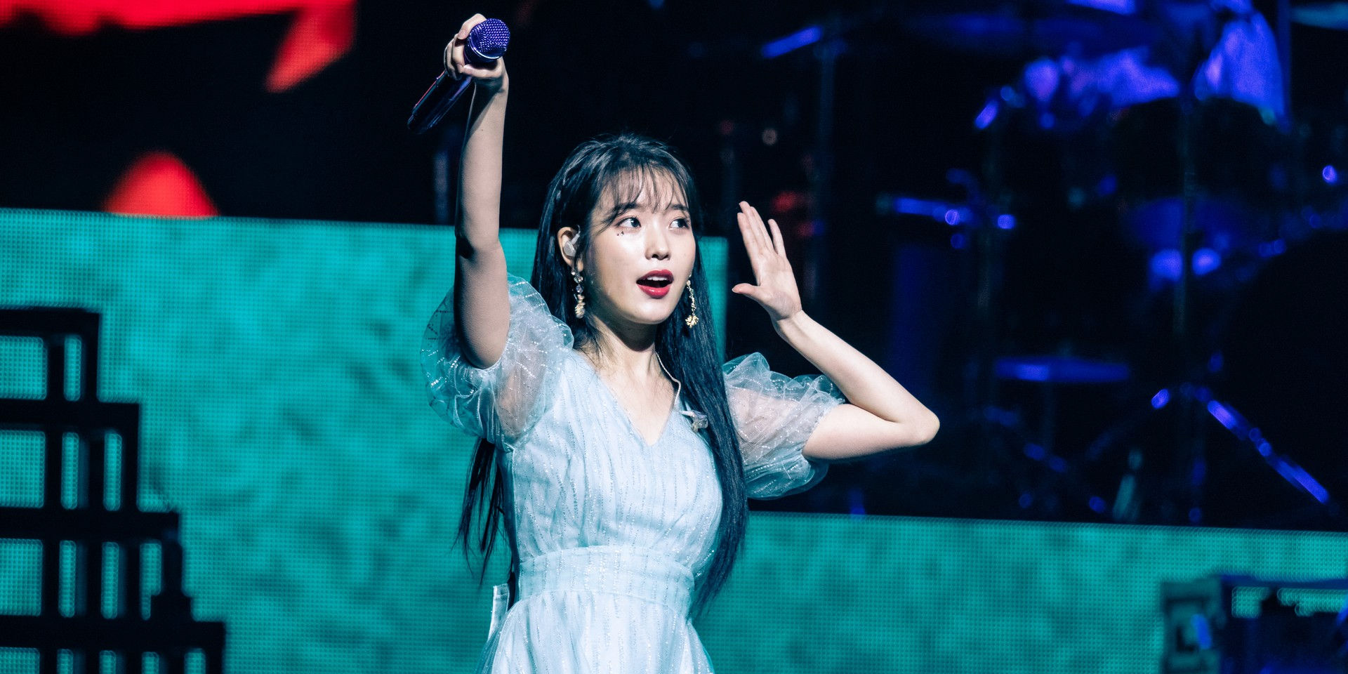 IU displays a special connection with fans at Singapore show – gig report