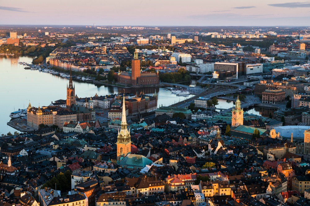 Aerial shot of central Stockholm featuring several churches, City Hall and the Riddarfjärden waterway.