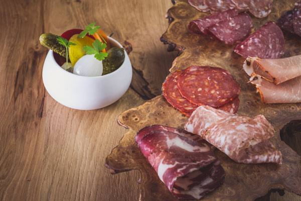 Charcuterie -><figcaption>Charcuterie - coppa, salami,</p><p>saucisson, pepperoni with pickles</figcaption></figure></p><p>e Barn serves around 400 covers a week, with an average spend per head of £35, and it offers a 43-strong wine list with a choice of 12 available by the glass.</p><p> Open five days a week (closed Mondays and Tuesdays), the restaurant is proving popular with both business and leisure guests.</p><p></p><p>