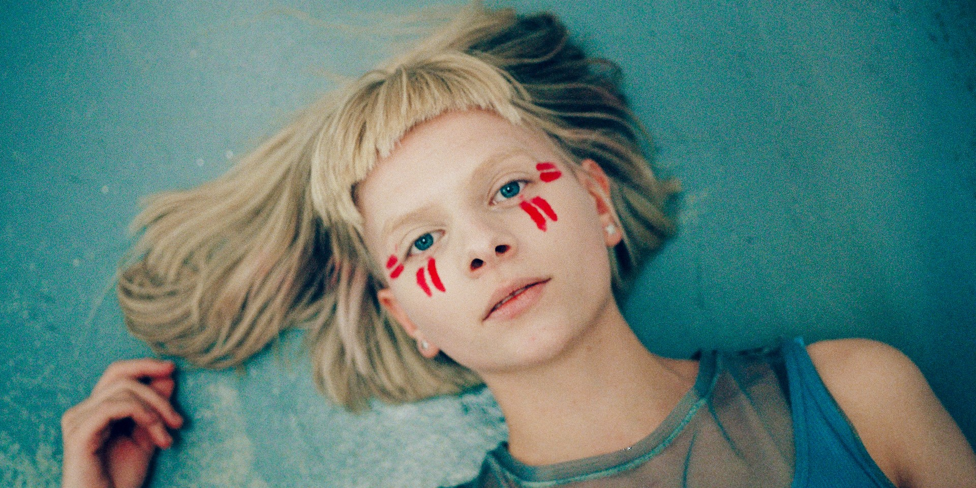 """""""It's about believing in all the tiny people who are actually very big"""": An interview with AURORA"""