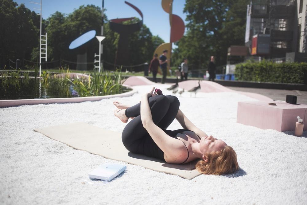 Yoga at 'Studio Ossidiana: Utomhusverket 2021'. Photograph: Sima Korenivski. Courtesy of ArkDes.
