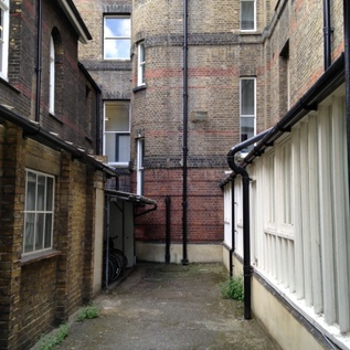 woman in black film location house