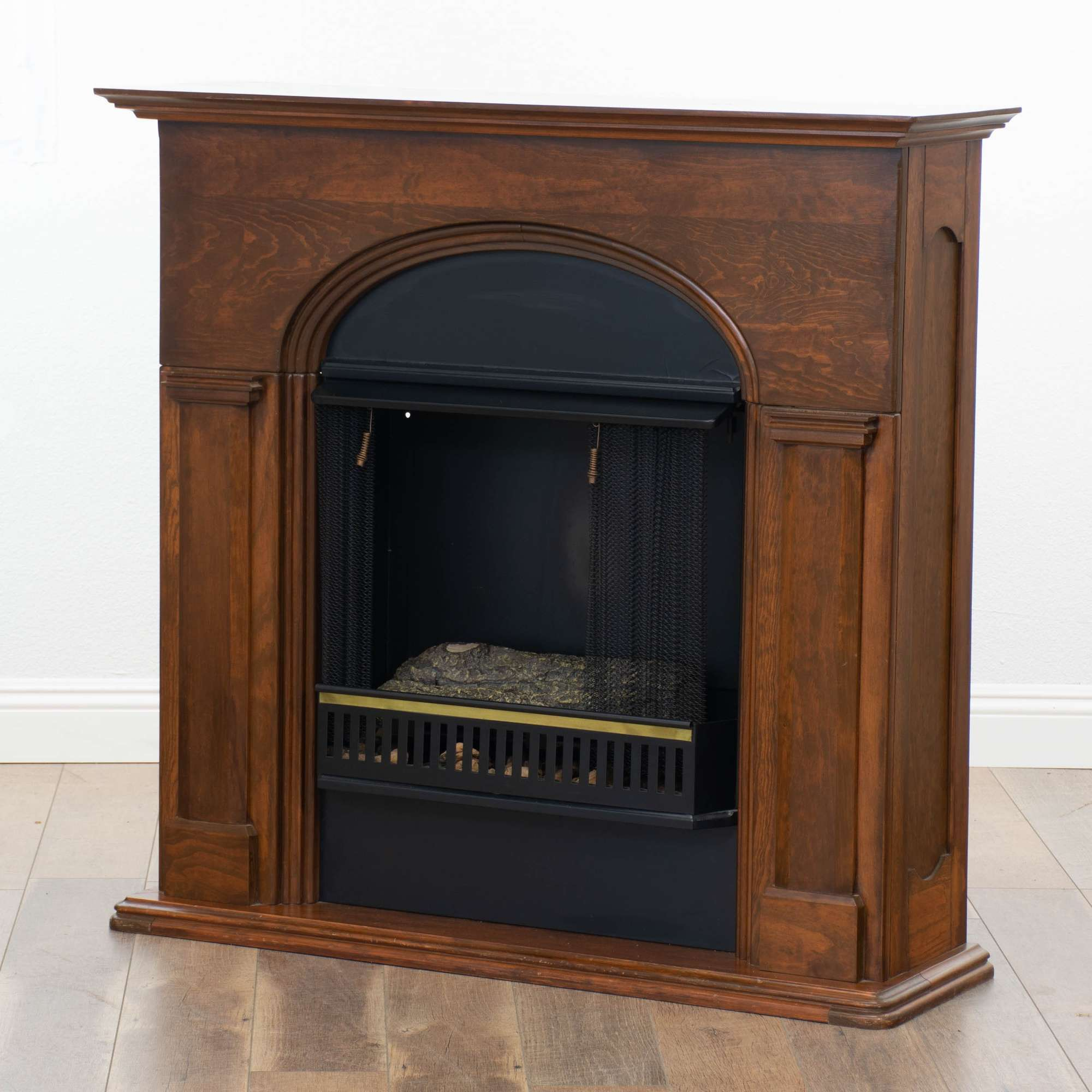 Jensen Co Fireplace With Logs And Arched Wood Mantel Loveseat