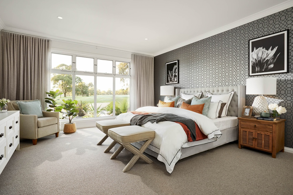 charming bedroom in this farm house style display home in drouin by beachwood homes