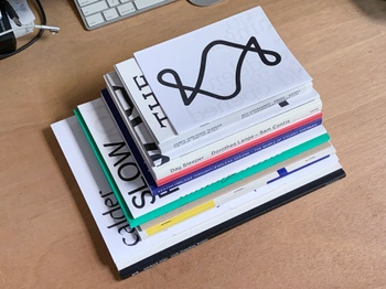 Stacked publications by Senior Critic and Assistant Director of Graphic Design Studies Julian Bittiner.