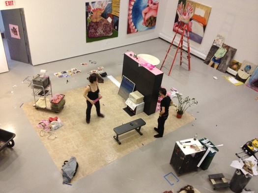 An aerial photo of a gallery space during the installation of work by the undergraduate class of 2014.