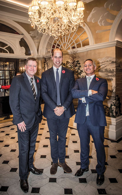 Mick Clarke, Prince William and Jeremy Goring at the launch of the Hotel School
