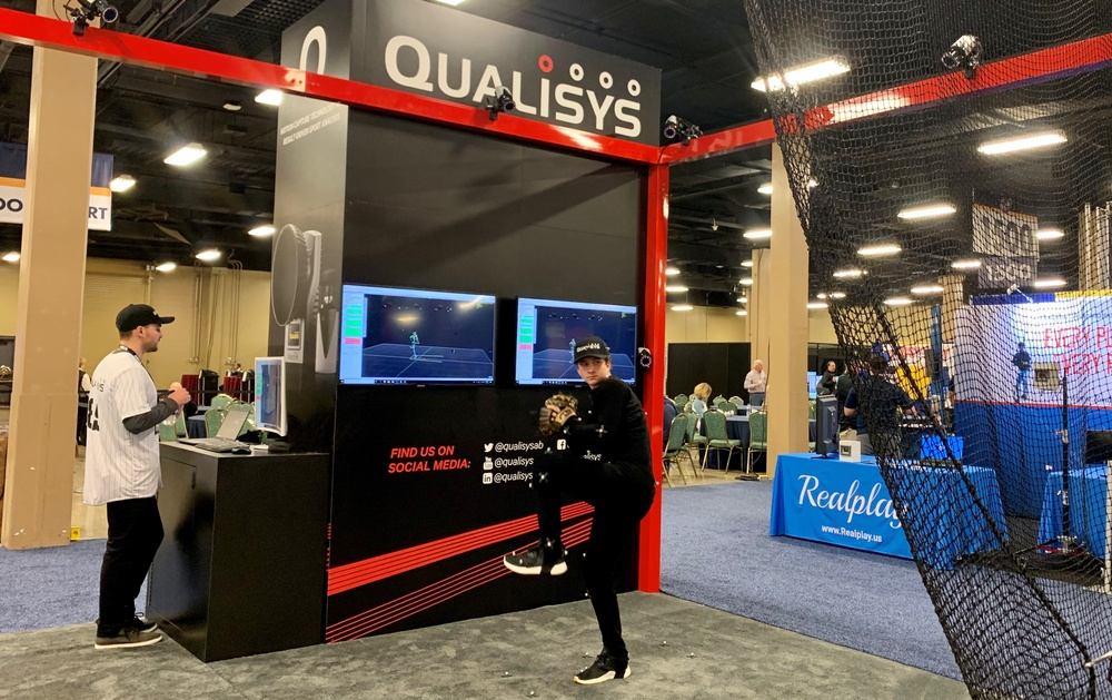 Qualisys' booth at the American Baseball Coaches Association annual conference demonstrates the practical use of optical motion capture, tracking 3D motion of aspiring baseball professionals with an interactive data-driven web report.