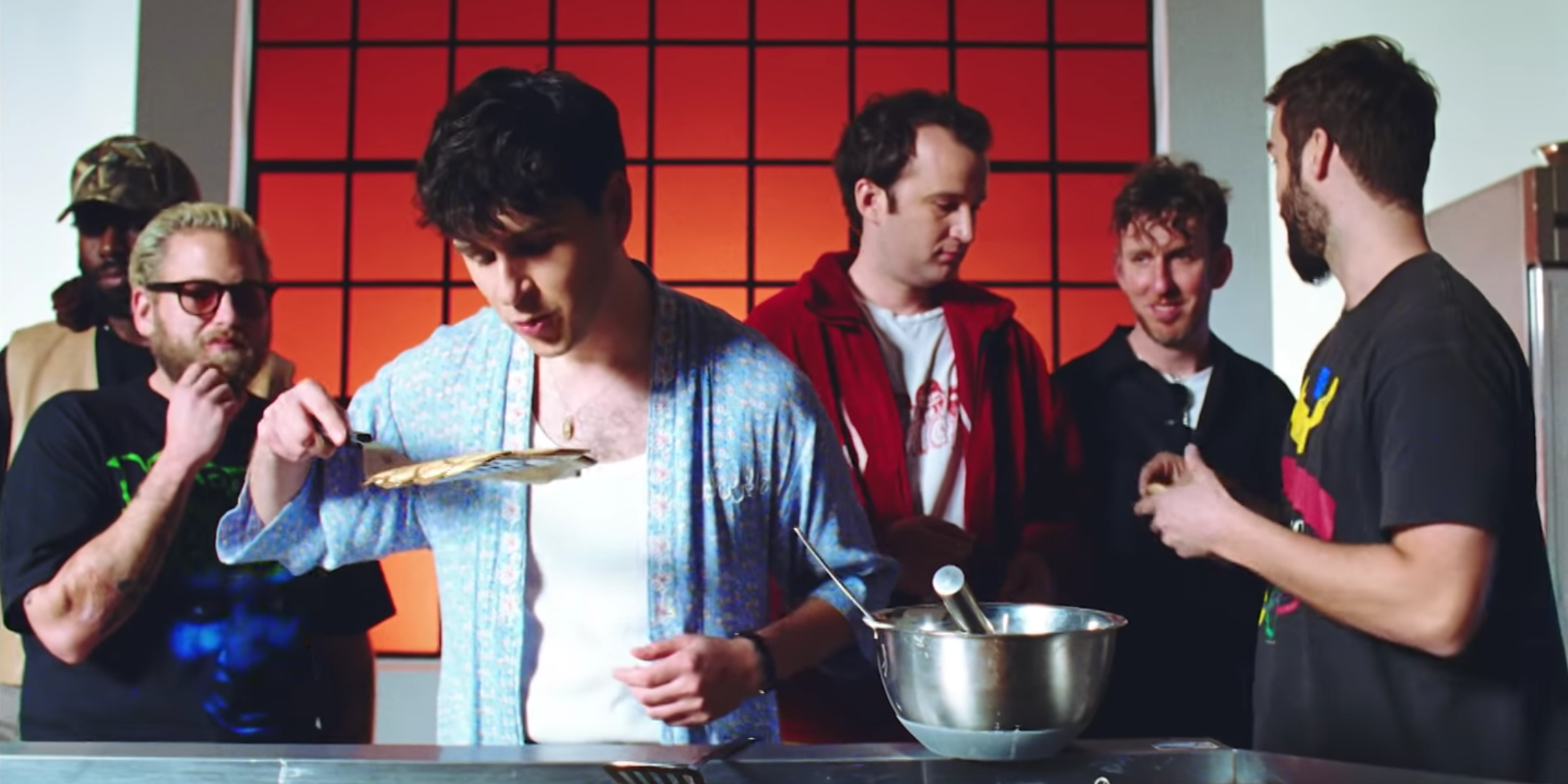 Vampire Weekend's Ezra Koenig flips pancakes masterfully for Jonah Hill and friends in music video for 'Harmony Hall' – watch