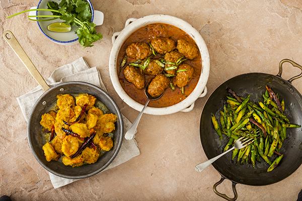L-R: Ghee prawns; shahi kofta; asparagus spiced with dried chillies and panchporan