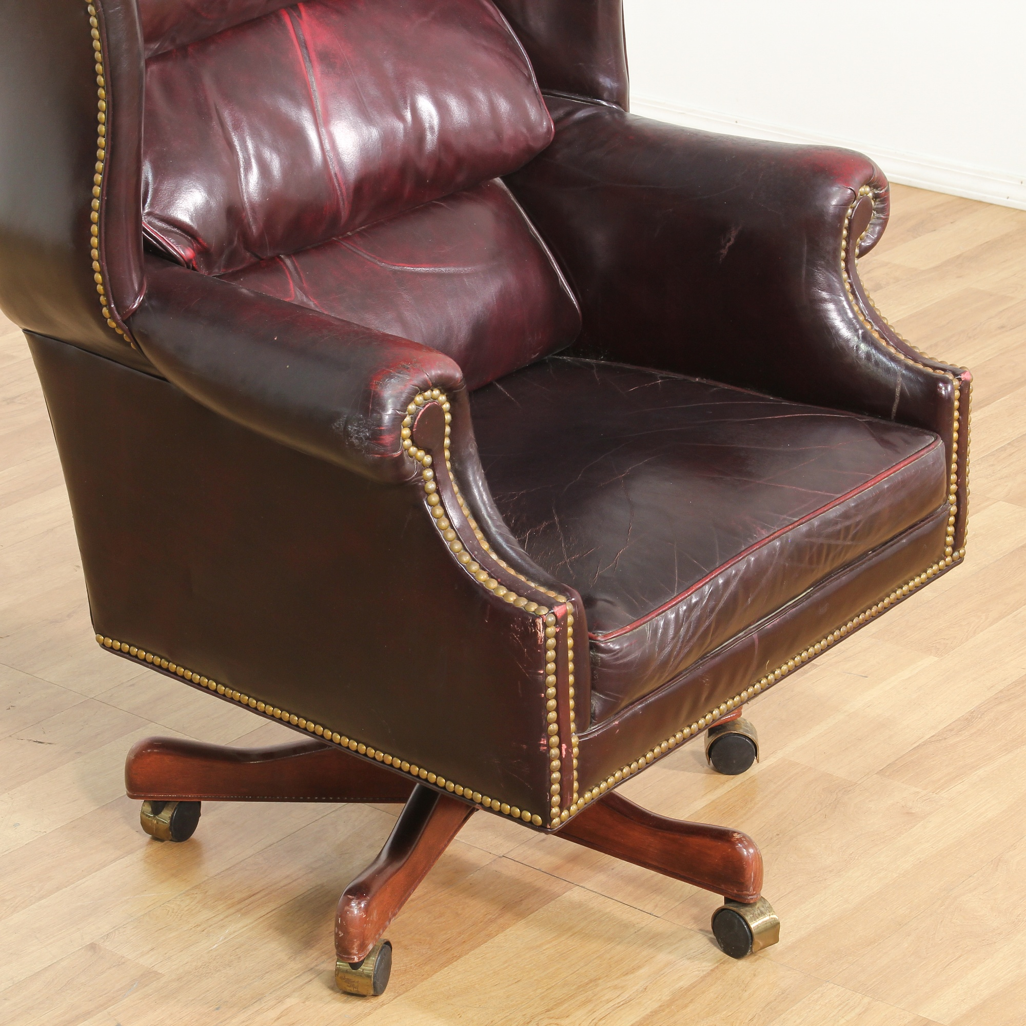 Leather brass studded burgundy office chair loveseat for Leather studded couch