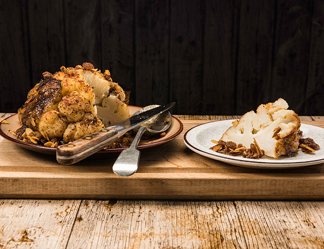 Whole roasted spiced cauliflower with almonds and sultanas