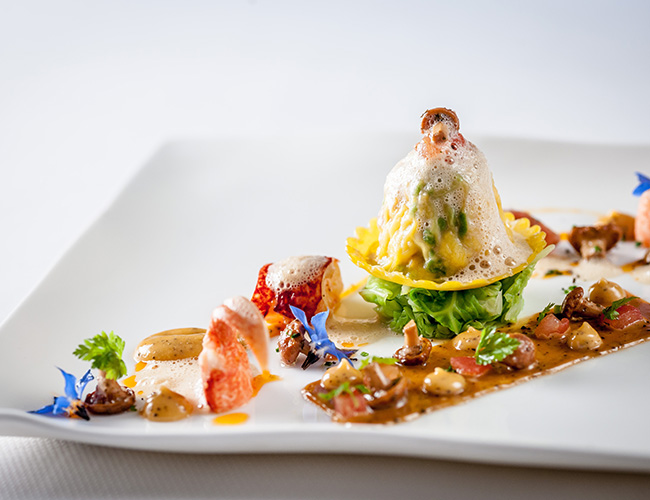 Lobster ravioli, lobster mayonnaise, girolle Á la grecque, lobster sauce by Michael Caines