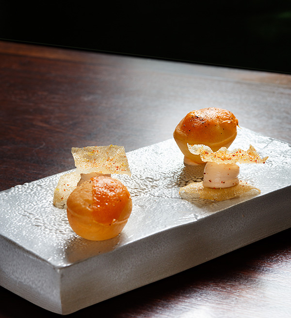Gnocco fritto with melted Red Leicester and black pepper, and wafer of smoked cod roe with piment d'espelette and lemon zest