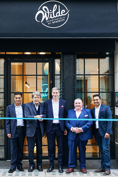 Left to right: Jason Delany, Director of Brand, Product & Marketing; Merlin Holland; Tom Walsh, CEO; Keith Freeman, COO; Atul Prakash, GM. Photograph by Jon Bradley.